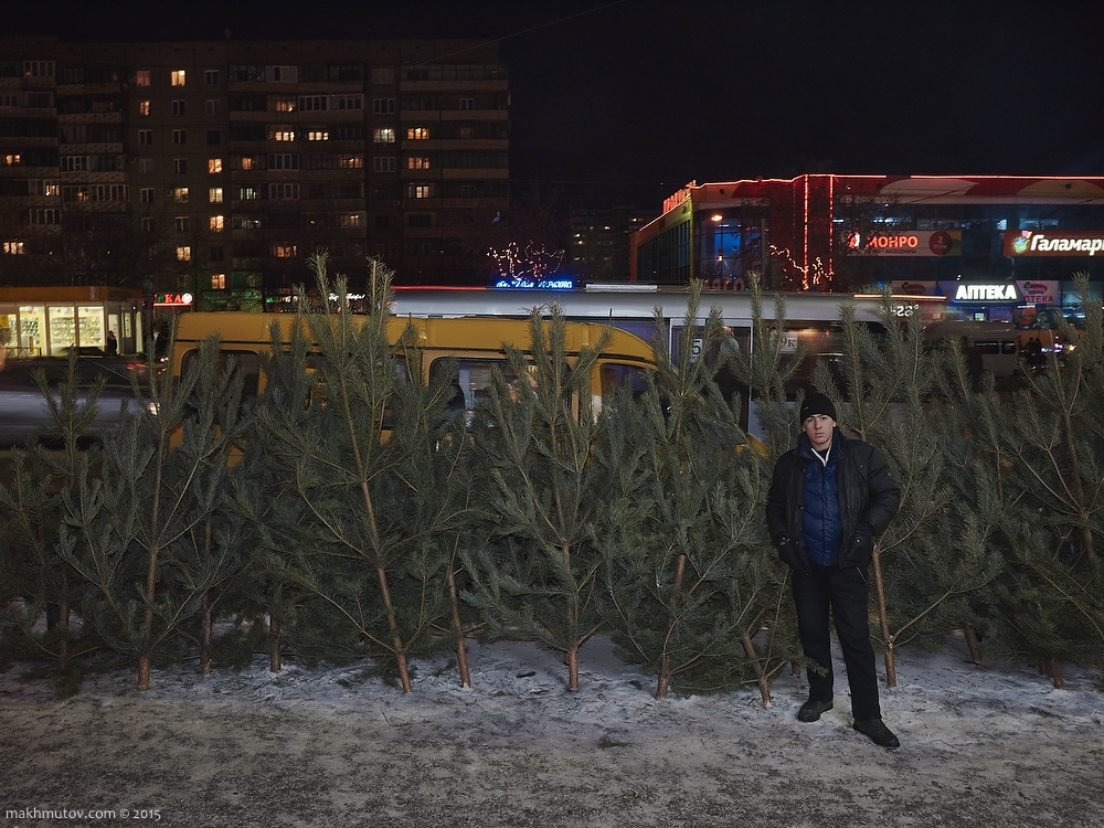 18:00 PM. Misha, street christmas trees seller.