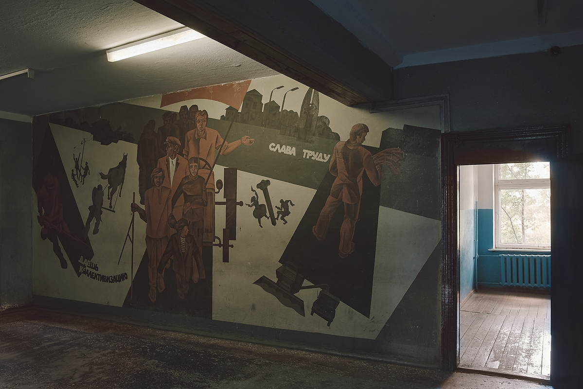 The soviet agitation wall painting in the town hall of the Cassel village.