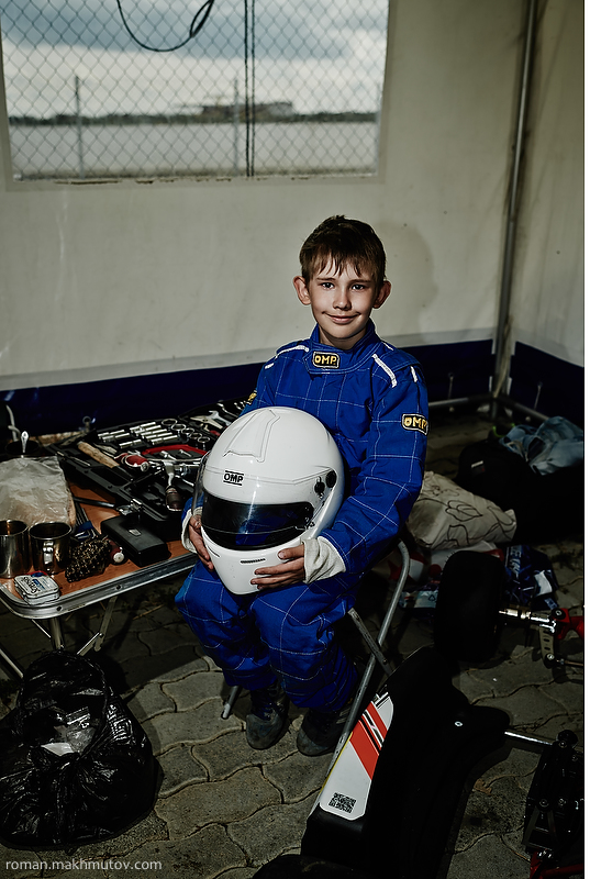 Misha, 9 years old. Racing for 4 years. Perm. equipment includes shoes, a racing suit, a helmet and gloves. All of that gets destroyed in accidents and crashes.
