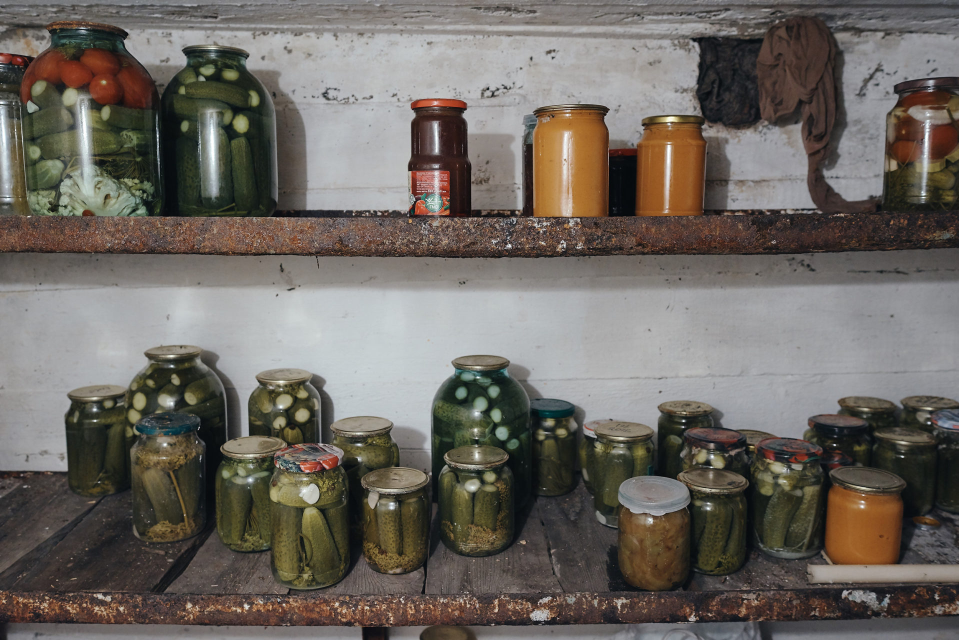 Canned fruits and vegetables. Food grown at dacha is preserved in cold basements (or in fridges), and it's good for years. Usually one dacha plot can provide food enough to support 3 generations of a single family over a year.